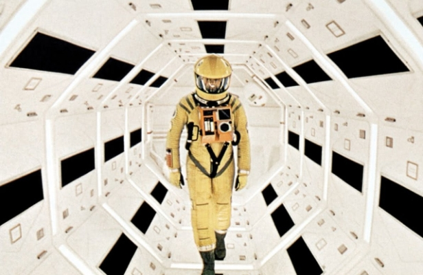 Bowman in a space suit walks a corridor aboard Discovery