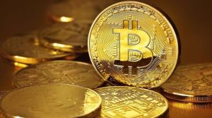 Bitcoins on a gold surface