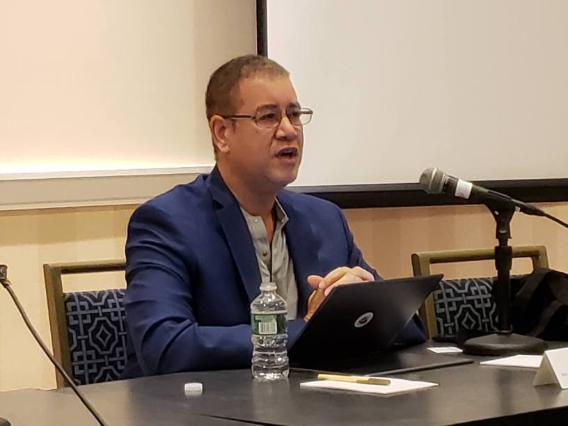 Steven Lyle Jordan leading a discussion about science fiction in media at Escape Velocity 2018.
