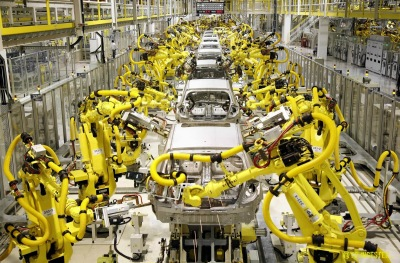An auto assembly line in which dozens of robots work in a human-free assembly area.