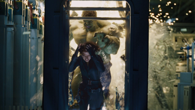 An enraged Hulk chases teammate Black Widow