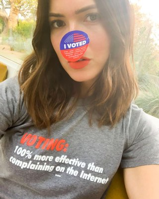 "Mandy Moore with an ""I voted"" sticker and a T-shirt that says ""Voting: 100% more effective than complaining on the internet"""