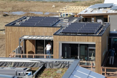 A Decathalon home with a sizable bank of solar cell panels on its roof