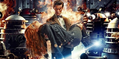 Doctor Who banner featuring the Doctor carrying companion Amy Pond as numerous Daleks are on fire or blowing up around them