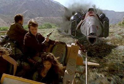 A Reaver ship chases the crew of Serenity on the open plain