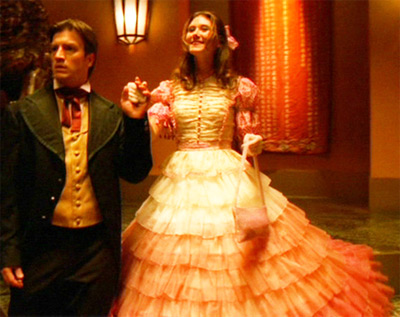 Mal and Kaylee attend a party in fine regalia
