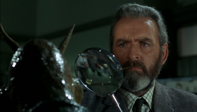 Bernard Quatermass examining the alien corpse found in a London Underground excavation site