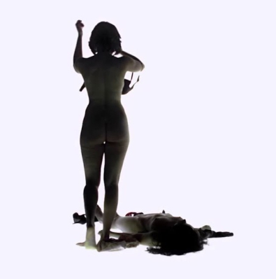 The Female strips the body of her clothing