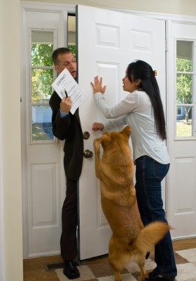 salesman fighting to get through the door
