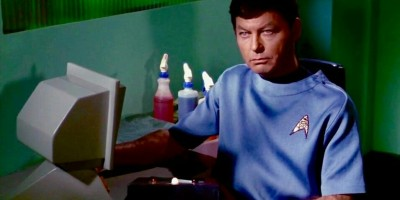 Dr McCoy at his desk