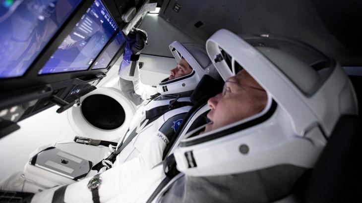 Astronauts aboard the SpaceX Falcon 9 Dragon capsule
