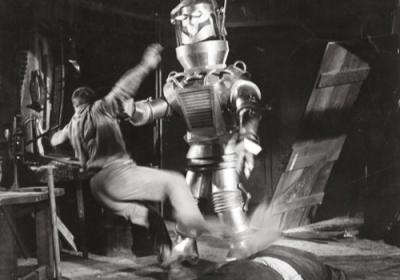 Tobor the robot attacks a man